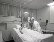 2016_107_036b ICU nurse and patient, 1973