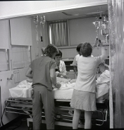 2016_107_055 ICU staff attending to a patient, 1976