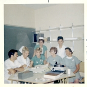 ICU staff and student nurses with projector. Gail Slessor is in white with white cap. July 1969.