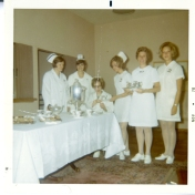 ICU nurses (Jean Highmoor is seated), likely at graduation. 1970.