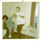 Judy Clark and unidentified man in the lounge, 1970.