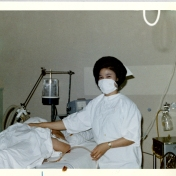 Nurse with patient in ICU, 1969