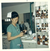 ICU nurse with medication, 1969