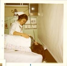 """Theresa """"Terry"""" Sawchuk with nurse Esther Sadevilla. December 1970."""
