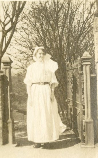 A.D. Allan, RRC [Royal Red Cross?] in gown, Buxton, England, March 18, [1918]