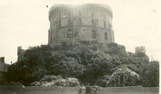 [Uiidentified building with 3 women standing in front. England]