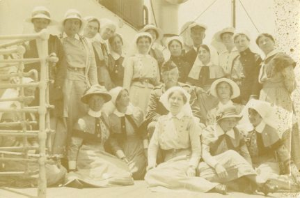 Captain Henderson, AJA [Alfreda Jenness Attrill standing second from right] and others. Enroute to Macedonia, 1916