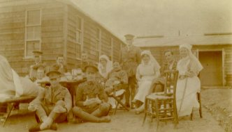 Afternoon tea outside of Officer's Hut at #5 CGH [Canadian General Hospital], Macedonia, 1917