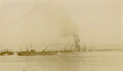 When an incendiary bomb ships in Salonika Harbour. Thessaloniki, Macedonia
