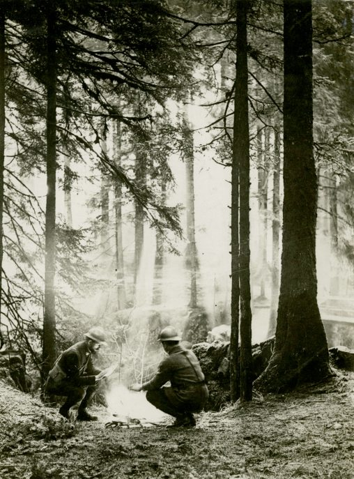 """The surroundings in which the French Armies fought in Alsace. Soldiers at a Camp Fire.""""French War Office Official Photograph. Authorised for Publication. Issued by Newspaper Illustrations LTD.""- France"