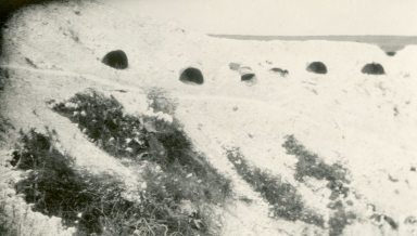 Dugouts in a shell hole at Vimy, France