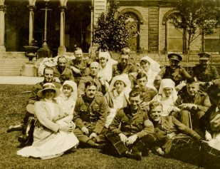 Officer patients and their [nursing] sisters including Miss Owen, masseuse. Buxton, June 1918. England