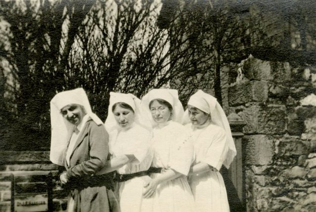 [Left to right:] Mrs. King Brown, Miss Hudson, Miss Merion, A.J. [Alfreda Jenness] Attrill. Buxton, May 1918, England.