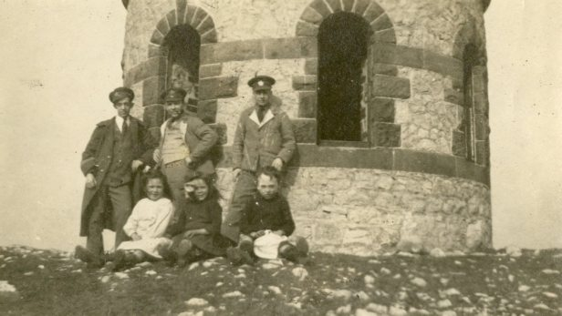 [Unidentified group at] Solomon Tower, Buxton. [Tower] built by a farmer in hard times after Napoleonic wars. Over the site of an ancient burial mound. England