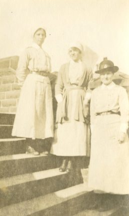 Sisters Hudson, Muirat, Attrill on step #1, Rochester Terrace, Buxton Mar. 1918, England