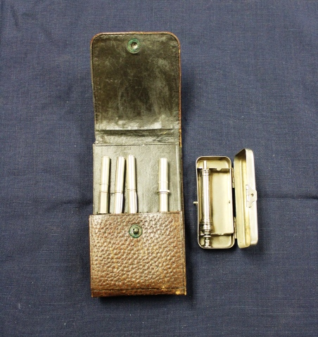 Alfreda Attrill's brown leather nurse's chatelaine with silver case and 4 instruments
