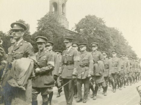 A group of officer patients [marching in Ada Ross funeral procession, July 18, 1918.]