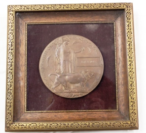 [Framed bronze medallion issued by the Canadian Government for Ada J. Ross. Given to the next of kin of those who lost their lives in war service both during and for a short time after the war.]