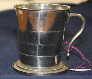 [Silver plated collapsible cup belonging to Ada J. Ross.]