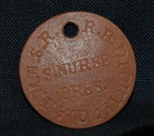 Ruby Dickie's Queen Alexandra's Imperial Nursing Service Reserve red identification tag.