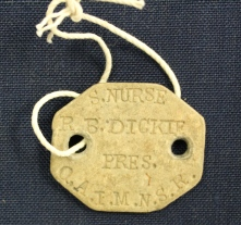 Ruby Dickie's Queen Alexandra's Imperial Military Nursing Service Reserve beige identification tag.