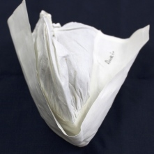 """Starched nurses cap with """"Dickie"""" marked on the cap in ink."""