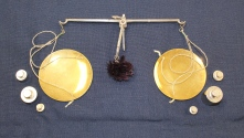 Silver scale with brass plates and no stand that belonged to Ruby Dickie. Include silver weights.