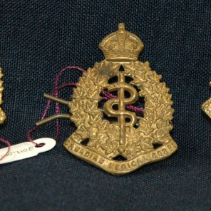 [Bronze Canadian Medical Corp Pins worn by Grace Conner.]