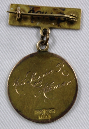 [Back of Winnipeg General Hospital School of Nursing Graduation pin engraved with name Miss Lizzie R. Aikman.]