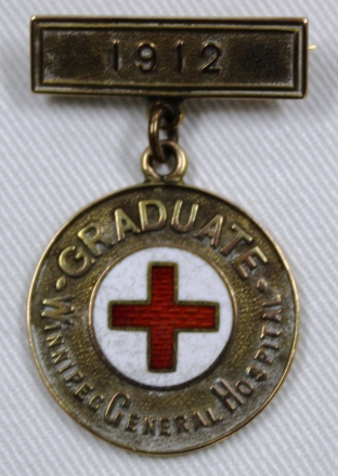 [Winnipeg General Hospital School of Nursing Graduation pin belonging to Lizzie Aikman, 1912.]