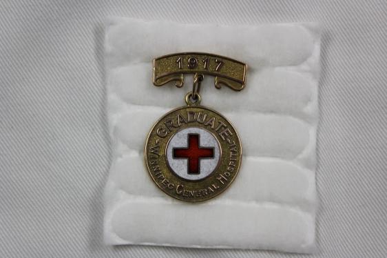[Martha Timlick's Winnipeg General Hospital School of Nursing gold pin, 1917]