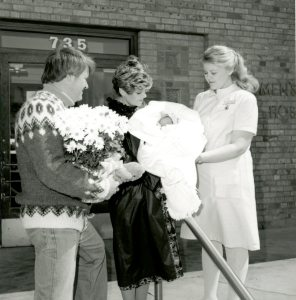 Laurie Temelton with the McLeod Family as they leave the Women's Hospital, 1950s. HSC Archives/Museum 2000.4.13 P4_P2_025