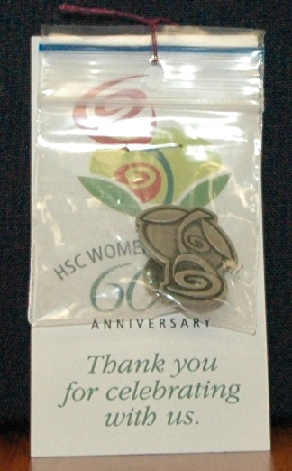 60th anniversary of Women's Hospital promotional pin, 2010. HSC Archives/Museum 2010_33_01