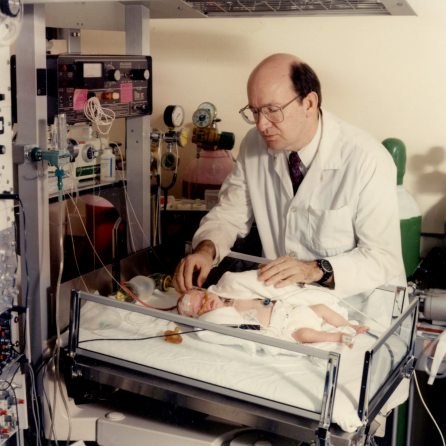 Dr. Henrique Rigatto with baby Kyle Grant in Neonatal Respiratory Control Lab, 1992. HSC Archives/Museum F3_Pn014_074