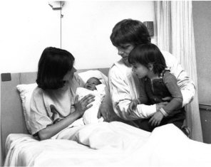 Family in hospital room with newborn. HSC Archives/Museum
