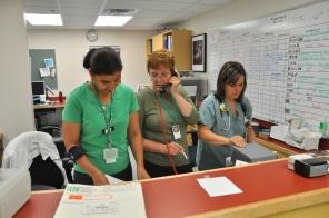 High Risk Area, personnel at front desk, 2009. HSC Communications