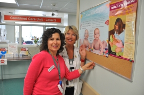 Susan Harrison and Kathy Hamelin putting up breastfeeding support posters, 2009. HSC Communications