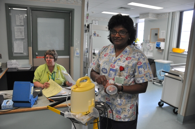 Theresa Setting up a breast pump, 2009. HSC Communications