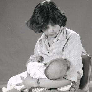 Norma Buckan breastfeeding at the milk bank, 1979. HSC Archives/Museum Negative Collection