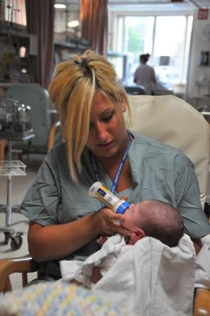 Feeding time in the NICU Intermediate Care Nursery, 2009. HSC Communications