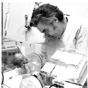 Staff with a newborn in an incubator. HSC Archives/Museum