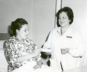 Annual silver spoon presentation to first-born baby and mother. HSC Archives/Museum White Cross Guild Collection